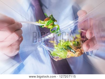 Healthy Office Food Eating Concept Photo. Office Worker Eating Diet Food. Salad From Plastic Container.