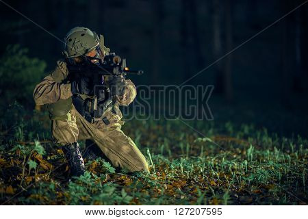 Soldier with Assault Rifle Night Time Military Operation.
