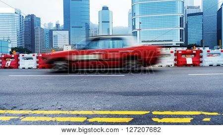 taxi driving on urban road,hongkong china.