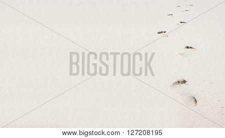 Foot steps on a beach