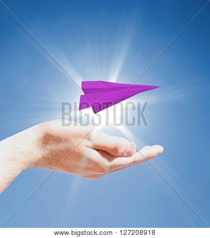 Holding a paperplane