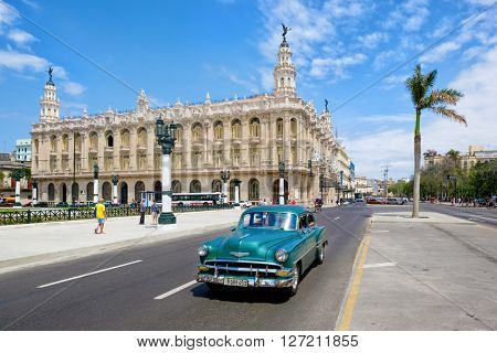 HAVANA,CUBA- APRIL 20,2016 : Classic vintage car next to the beautiful Great Theater of Havana at the city downtown