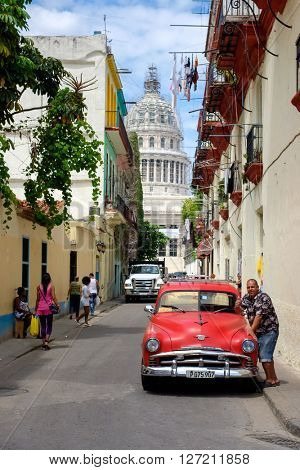 HAVANA,CUBA - APRIL 20,2016 : Street scene in Old Havana with a vintage classic american car and the Capitol building