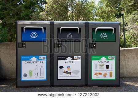 Berkeley CA - April 24 2016: Recycling Landfill and Compost garbage bins on UC Berkeley campus. University of California Berkeley is involved in many innovative projects aimed at reducing waste.