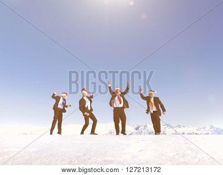 Businessmen celebrating christmas on snow covered mountain.