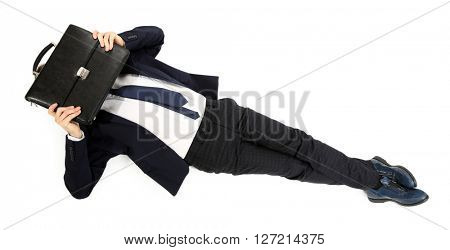 Young businessman with bag lying on the floor