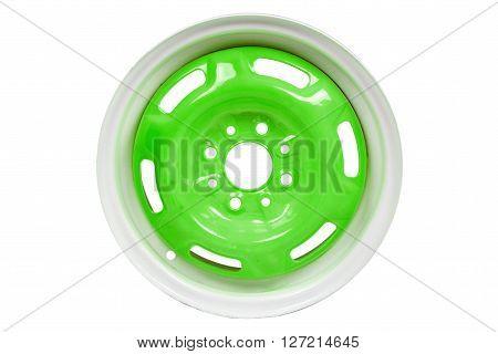 Powder coating of light green wheel disk on white background