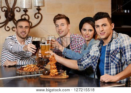 Group of young people spending time in bar