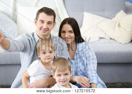 Happy family making selfie in new house