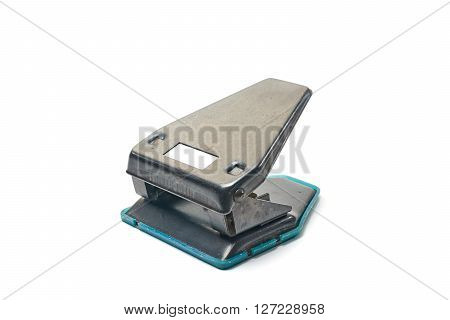 vintage office hole punch device for folder isolated on white background