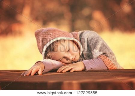 Little kid head on bench sleeping