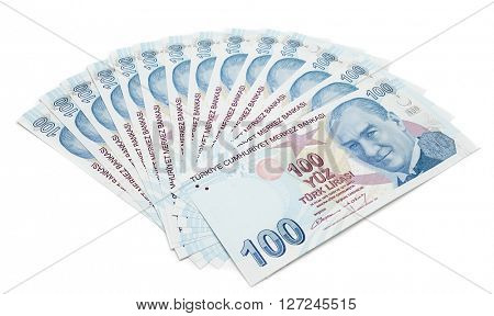 One hundred Turkish Lira bills isolated on white background.