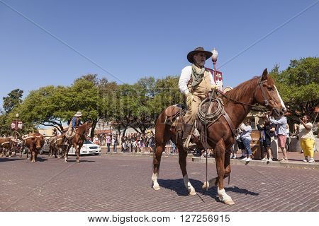 FORT WORTH TX USA - APR 6: Cowboys in the Fort Worth Stockyards historic district. April 6 2016 in Fort Worth Texas USA