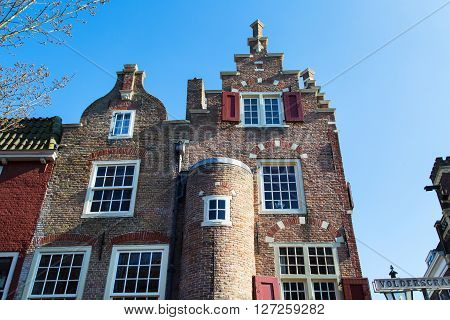 Delft, Netherlands - April 8, 2016: Colorful traditional dutch houses  in downtown of popular Holland destination Delft