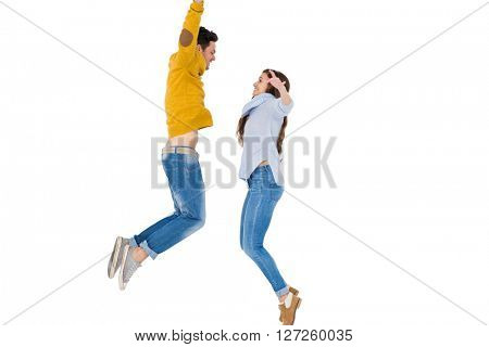 Happy couple jumping together on white background