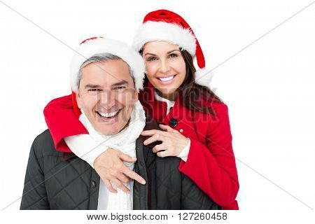 Festive couple with santa hat embracing on white screen