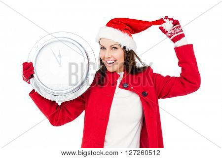 Beautiful brunette with santa hat holding a clock on white background