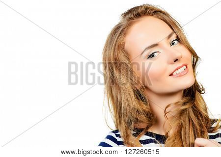 Pretty woman with beautiful long hair smiling at camera. Studio shot. Isolated over white background.
