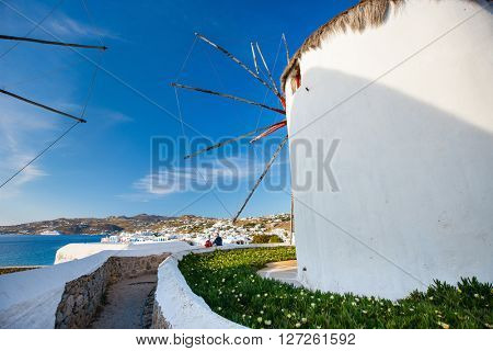 White greek windmills overlooking Little Venice popular tourist destination at traditional village on Mykonos Island, Greece, Europe