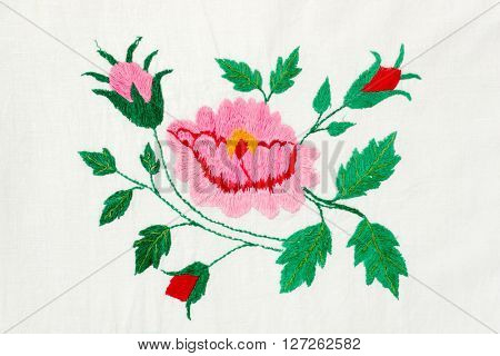 embroidered pink and red flowers