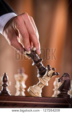 playing wooden chess pieces, close-up.