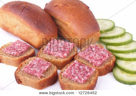Sandwiches with sausage and rye bread with cucumber isolated on white background