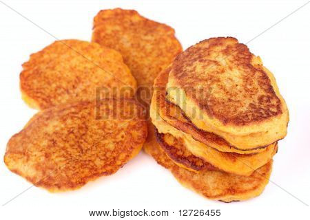 Homemade fried pumpkin pancakes for breakfast isolated on white background