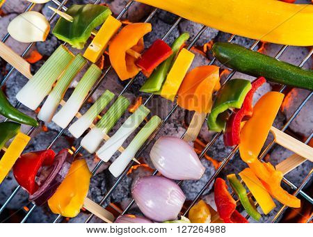 Grilled skewers and vegetables. Garden barbegue.