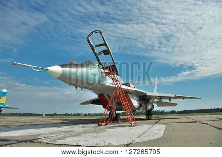 Vasilkov Ukraine - June 19 2010: Ukrainian Air Force MiG-29 fighter plane parked on the apron on the airbase preparing for a training flight