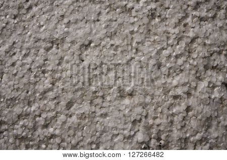 Old grunge dotted yellow styrofoam texture background
