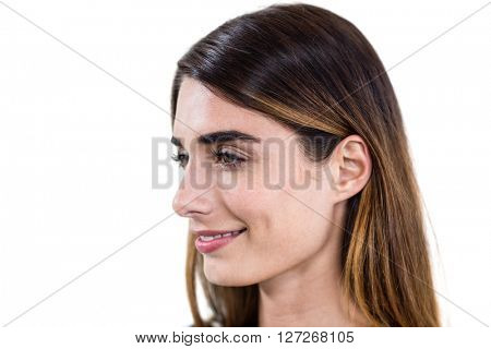 Close-up of smiling woman standing on white background
