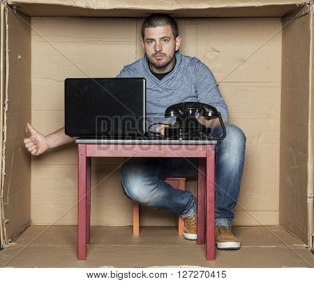 Young Office Worker Shows Thumbs Up Under The Desk