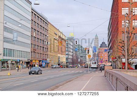 HELSINKI, FINLAND - April, 4, 2016: traffic on a street of Helsinki, Finland.