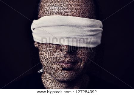 closeup of a young man patterned with no-sense words with a blindfold in his eyes, depicting the idea of lack of press freedom