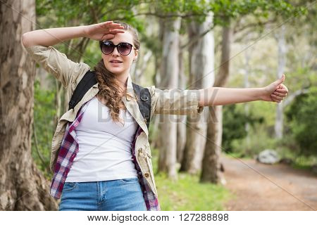 Portrait of woman hitch hiking in the countryside