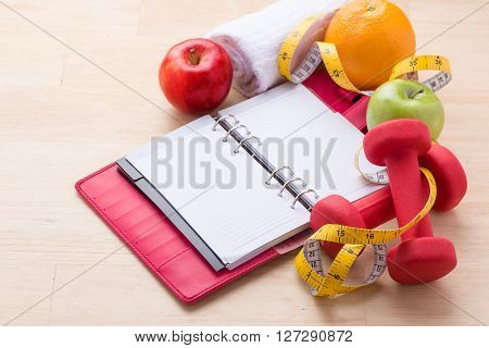 Modern healthy lifestyle fitness diet concept with objects on wooden table.