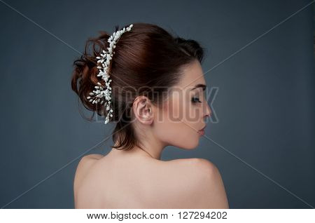 Bridal hairstyle. Brunette with curly hair and beaded headpiece. View from the back.