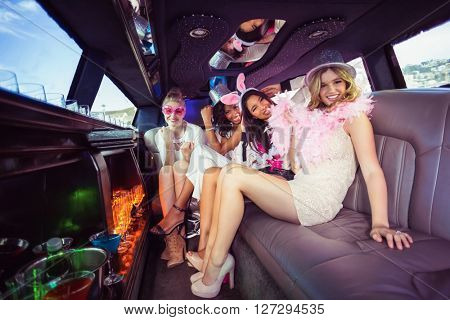 Frivolous women in a limousine on a night out
