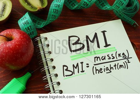 BMI body mass index  (metric formula) written on a notepad sheet.