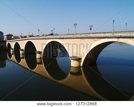 Reflection of one of the bridges across the Dordogne river into Bergerac