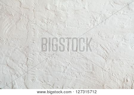 Vintage or grungy plaster wall as a whole white background.