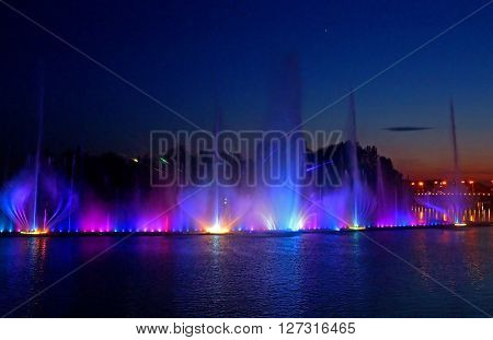 VINNYTSIA, UKRAINE - MAY 31, 2015: Biggest fountain on the river in Vinnytsia ,Ukraine. Located in the river Southern Buh fountain has a length of 140 meters and the height of the jet up to 60 m ** Note: Soft Focus at 100%, best at smaller sizes