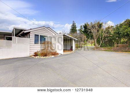 Old Small House With A Very Large Drive Way