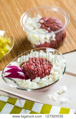 Dish with raw seasoned red meat called