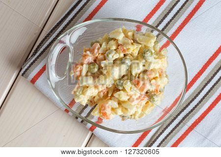 Multi vegetable salad in glass bowl on textile