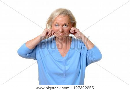 Elderly Woman Pulling At The Skin On Her Jowls