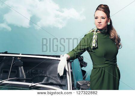 Retro 1960S Woman In Green Dress Standing Next Sportscar.