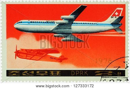 MOSCOW RUSSIA - APRIL 10 2016: A stamp printed in DPRK (North Korea) shows American passenger aircraft Douglas DC-8-53 and old airplane series