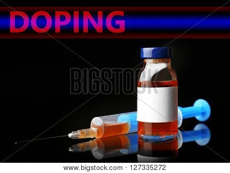 Stop doping concept. Ampule with syringe isolated on black