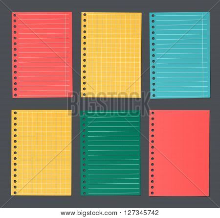 Bright colorful lined and squared notebook paper are stuck on dark background.